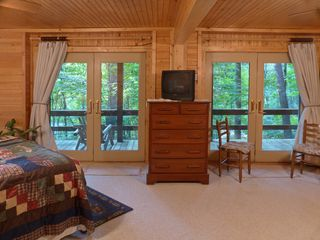 Maggie Valley cabin photo - Relax in the rockers or swing on the wrap around deck