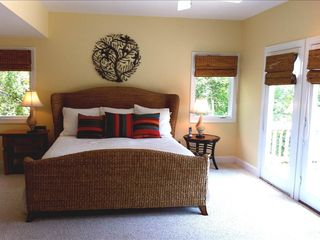 Bald Head Island house photo - The main master bedroom, with a tranquil spa-like decor and marsh view