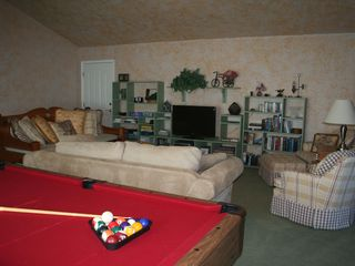 Auburn house photo - Upstairs enjoy the Casual Family Room- TV, pool table, games and a toy closet.