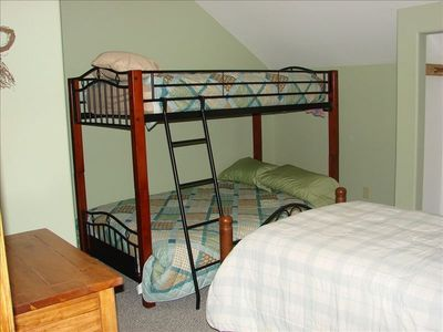 Bunk room with twin upper, full lower, and separate twin bed.