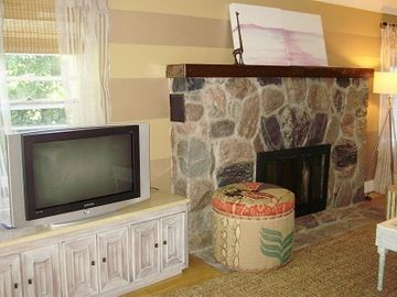 Beautiful natural stone fireplace in living room.