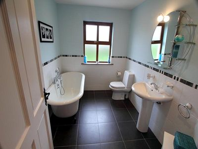 One of the two additional main bathrooms with beautiful claw bath.