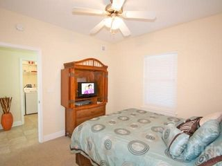 "Gulf Shores condo photo - Guest bedroom with queen sized bed and 21"" flat screen TV"