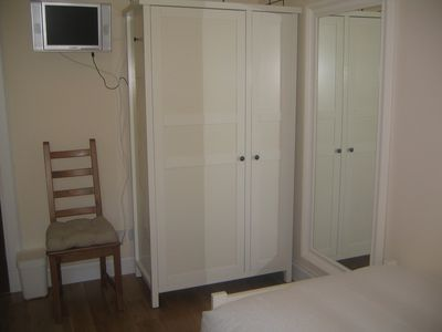 Each bedroom with wardrobes and a television