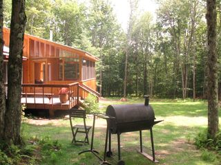 Screened porch and barbeque in back yard - Claryville cabin vacation rental photo