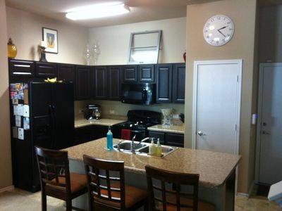 Kitchen with island, dish washer, oven, microwave, full refrigerator, & pantry!