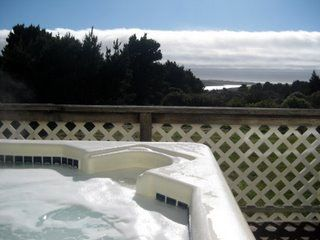 HOT TUB OVERLOOKS 43 ACRES AND FRESH WATER LAGOON. OCEAN IN THE BACKGROUND