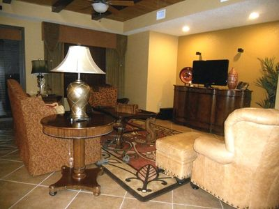 Celebration condo rental - Living room with flat screen, DVD, stereo, CD.