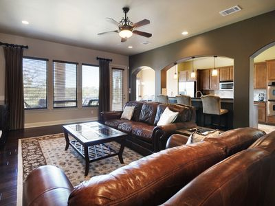 Spicewood house rental - Main floor with view of balcony, kitchen and seating area