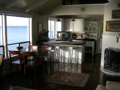 Upper Level Unit: Not shown - Seagrass rugs and TV on wall over kitchen counter