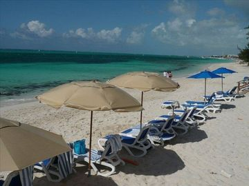 Reef Residence has loungers & umbrellas on Grace Bay Beach