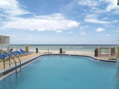 Swim or relax by the poolside and enjoy the fabulous Gulf view