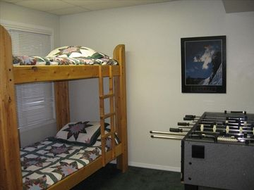 Bunk beds and foosball on lower level