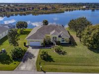 Total Retreat - Beautiful Lake Front Estate Home, minutes to Beaches & Shopping