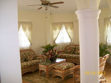 Alternative view of living room with Greek pillars in foreground