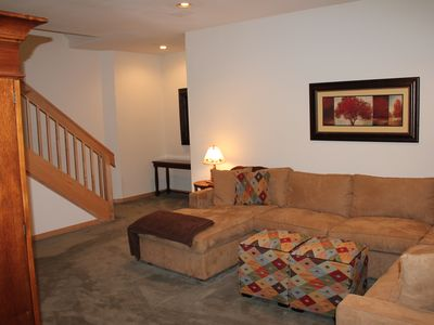 Lower level living area has pull out sofa bed