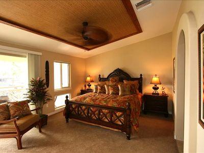 Master bedroom with king bed, private lanai, spacious master bath