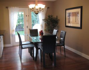 Calgary house photo - Dining area with 6 chairs and a view of treed backyard!