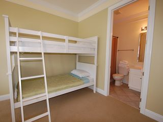 Fort Morgan property rental photo - The first floor King Suite has a bunk and a full bath. Perfect for family of 4.