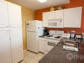 Orange Beach condo photo - Fully equipped kitchen