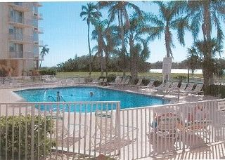 Fort Myers Beach condo photo - Great Pool Area with plenty of chairs