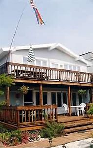 Harvey Cedars house rental - BACK DECK LOOKING TOWARD OCEAN, BOCCIE BALL COURT, VOLLEYBALL COURT