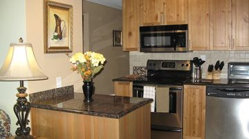 Kitchen, granite counter tops and stainless steel appliances