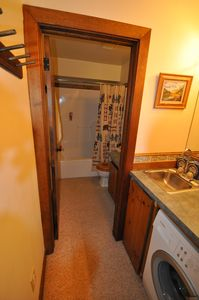 Upstairs bathroom and shower with Bosch washer and dryer. Only washer visible.