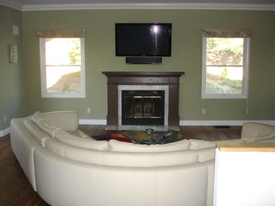 Second wood burning fireplace, and large screen TV