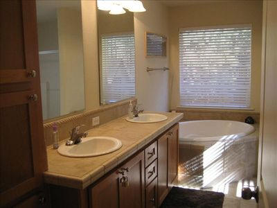Master bath includes a romantic 2 person soaking tub, shower and dual vanity .