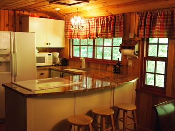 quaint country kitchen with farm sink & granite counter tops