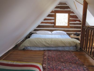 Loft bedroom, above kitchen. King bed and Single bed. Kids like.