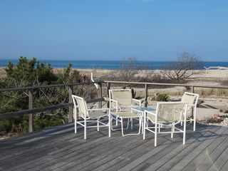 Peconic house photo - Large outdoor deck sits above the sand and dunes. 300' private walk to the beach