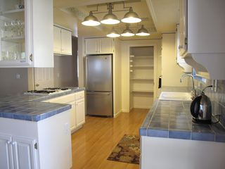 Gourmet kitchen with stainless refrigerator and pantry - Montgomery Estates house vacation rental photo
