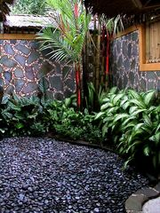 Sanur house photo - View of garden & mosaic wall from outdoor shower in master bathroom