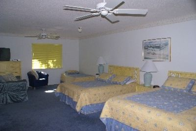 Fourth bedroom with 2 Queen Beds and a Twin Bed, TV/DVD, Couch/Chair, bathroom