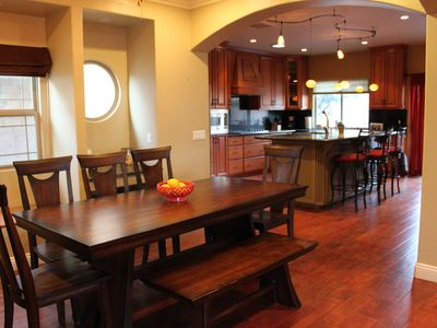 Be Our Guest! Open dining, kitchen and living area