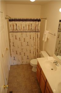 Spotless private master bathroom with double sinks and tub/shower combo