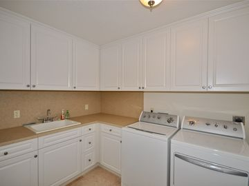 Utility Room with washer, dryer and cabinets