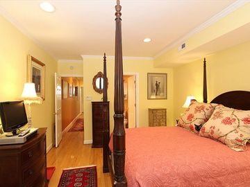 Private Master Bedroom Suite with queen poster bed and huge closets.