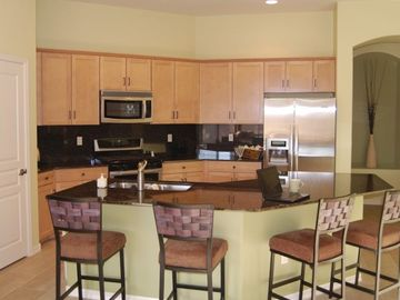 Stainless steel appliances, granite and additional seating in the lovely kitchen