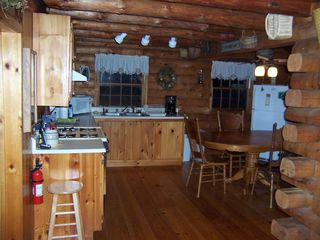 Lake Hortonia cabin photo - Open floorplan, spacious fully equipped kitchen + dining room nook table