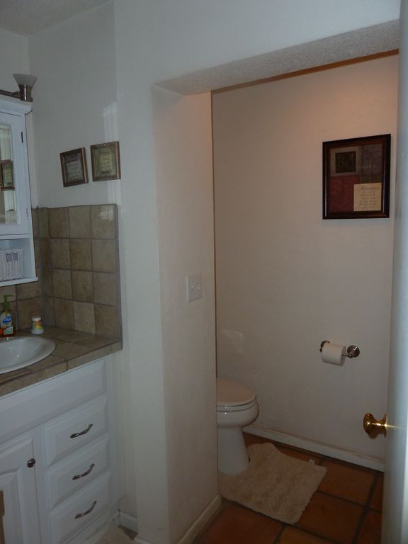 half bathroom off kitchen