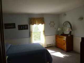 Jefferson farmhouse photo - Blue bedroom with double bed and child sized bed.