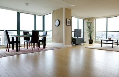 Low angle shot of living room and dining room. Look at those beautiful floors!