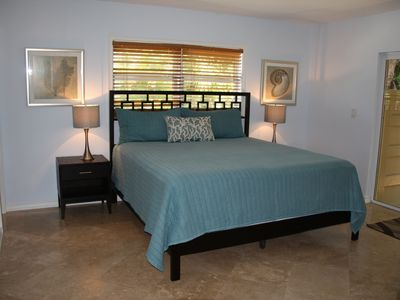Master Bedroom with king bed and walk-in closet. Entrance to patio.