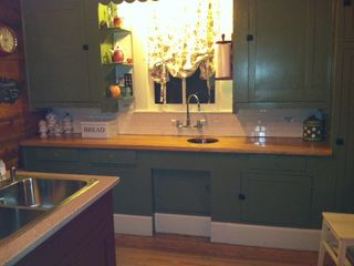 New Braunfels house photo - Wood countertop and vegetable sink