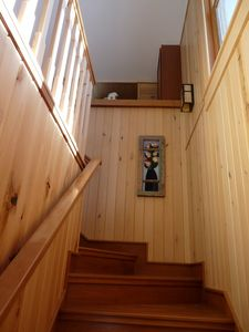 Cherry wood stairway with basswood walls.