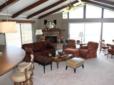 Family room with bar, min fridge, 50 inch 3 D TV, game table with view deck