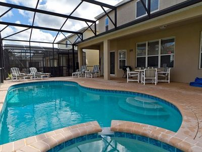 Lots of Seating by the Pool and Spa! Grill included!